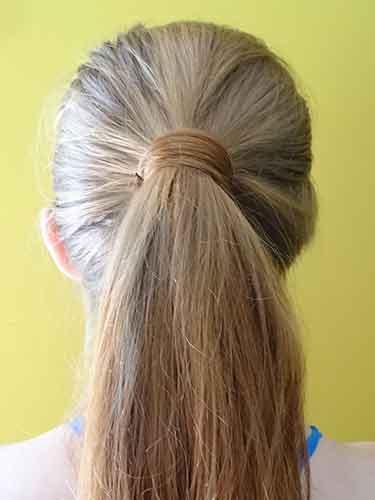 Recoge tu pelo hacia atrás.